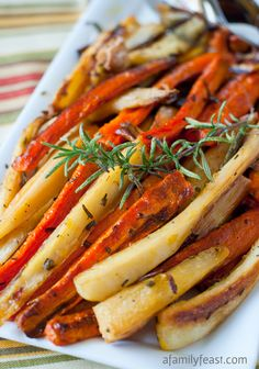 Roasted Carrots and Parsnips - A simple, delicious and elegant side dish for any meal!  So easy and super flavorful!