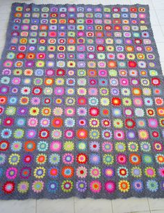 colorful crochet granny square blanket by handmadebyria on Etsy