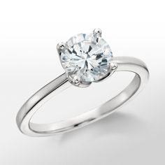 Monique Lhuillier Solitaire Engagement Ring - classic and classy  again. i try not to - but man I just like the classic stuff
