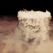 Whether you're putting on a theater production, a Halloween show or making a low-budget movie, dry ice lets you make a non-toxic fog machine at home. Dry ice is frozen carbon dioxide. It's much colder than normal ice made of frozen water, and when placed in hot water it produces a lot of smoke that then sinks to the ground and can be blown in...