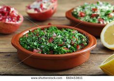 tabbouleh in ceramic bowl on rustic table background