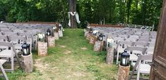 Pews and chairs wood stumps with lanterns and mason jars and signs