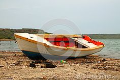 old colorful painted boat on a beach