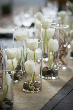 vases filled with white tulips wedding centerpiece // spring tablescape, modern, rustic, burlap