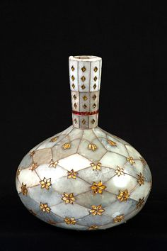 Surahi, the vessel with high neck 18th century Place of Origin: Mughal Materials: Jade, gold wire and leaf, glass and ruby National Museum, India.