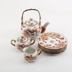 Japanese Hand Painted Porcelain Teapot, sugar bowl, creamer / jug, & plates in gold & red dragon design on white ground