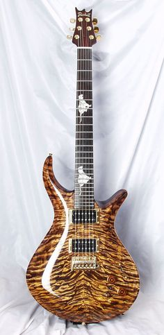 Driskill Guitars Custom Anton (Tigers on the fretboard are an inch and half high. Two tigers consist of 4 types of shell. There are 98 individual pieces. Every curve and point is a perfect match, as you move the fretboard, the whole thing flashes in iridescent blue, pink, and gold)