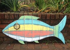 Fish Sign Tropical Wall Art Beach House Weathered Wood Decor by CastawaysHall This big weathered wood fish is so cool. He gives off a tropical vibe. He might be a squirrel fish, he might be a type of tuna. He has lots of layers of colour; turquoise, yellow, brown, sea green, aqua green, coral and hes highly distressed to show all the layers and give him that unique vintage look. He is also made with varying vintage pieces for his eye. Eyes will vary as they are vintage and one of a kind…