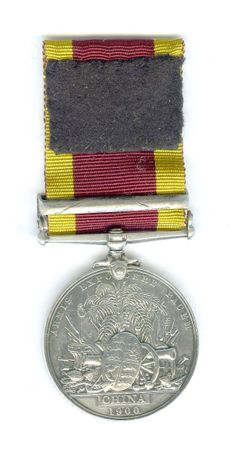 Reverse side of the China Relief Expeditionary Medal 1900, with Relief of Pekin clasp awarded to F.J. White, Orderly, assigned onboard the H.M.S. Barfleur, who was wounded at Tientsin, 13 July 1900.  White sustained a bullet wound right achilles tendon.
