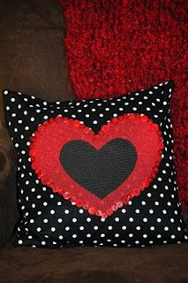 2 different cute heart decorated pillows