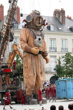 Giant diver in Germany Members of Royal De Luxe lift a 9.5-meter-tall giant puppet from the river Spree in Berlin, on October 3, 2009.