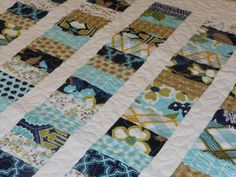 Modern Meadow Coins Baby Quilt --, blue, navy, aqua, tan, white, green. $130.00, via Etsy. - Like this color scheme