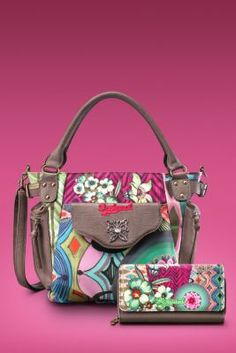 Desigual McBeen Ishburi bag, our latest offering in bags. It has a single inner compartment and pockets on the outside. Short handle and long detachable strap. Zip fastening.