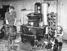 """Federal B cook-stove - """"An old woman working in the old fashioned kitchen while the young girl plays with her kitten"""" Photograph by Bernard Hoffman, Maine, Source: LIFE Photo Archive, Antique Photos, Vintage Pictures, Vintage Photographs, Old Pictures, Old Photos, Old Kitchen, Vintage Kitchen, Kitchen Decor, Kitchen Sink"""