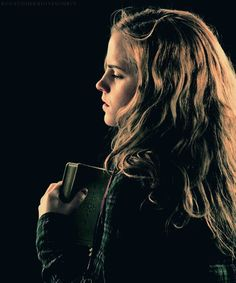 Hermione Granger. (I absolutely want a photo of me like this... the lighting, and clutching a book...)