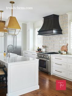 This is one of our Montrose Range Hoods in our Dark Washed patina. We can't get enough of this gorgeous kitchen! In collaboration with Tru Kitchens Design Photography by: Ashley Avila Photography Lake Cottage, Cozy Cottage, Cottage Homes, Modern Classic, Modern Rustic, Craftsman Lake House, Hickory Hills, Cottage Renovation, Modern Cottage