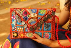 Beautiful clutches made one at a time in Kutch Gujarat by kutchi women. Antique sikkas on the V flap.Two zips inside. Size- 11 X 7 Indian Accessories, Time Is Money, Jewellery, Jewels, Hand Bags, Antiques, Clutches, Ethnic, Beautiful