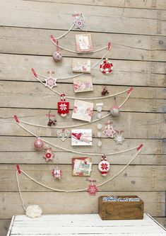 Easy Ideas for Handmade Christmas Decor. Spread holiday cheer with these Wall Christmas Tree - Alternative Christmas Tree Ideas and other holiday ideas. Wall Christmas Tree, Noel Christmas, All Things Christmas, Winter Christmas, Simple Christmas, Christmas Lights, Minimalist Christmas, Xmas Trees, Christmas Kitchen