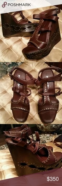 Wedge wood bottom platform sandal ALL Leather New Wedge wood bottom platform sandal.  Beautiful detail carving on the bottom.  ALL LEATHER.  Brown luxurious leather! New , never worn,  bottom clean,  comes with original box.  High end boutique brand Violet Tash.  No trades Violet Tash  Shoes Platforms