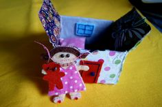 Little felt doll with house