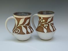 White glazed mugs