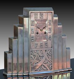 "Art Deco silverplated skyscraper clock. French. Circa 1930. 35cm high 31cm width = 13.8"" high 12.2"" width."
