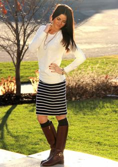 long solid sweater + long striped skirt + warm socks + riding boots.