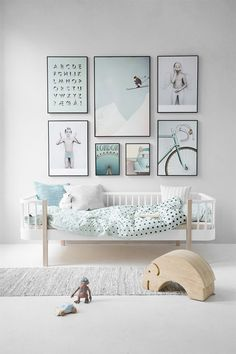 Arrangement of pictures over bed - gymnastics prints/quotations Love this little boys bedroom. Soft blues to add some character.