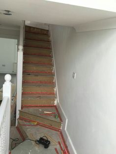 The carpet gripper is attached to the wooden stairs