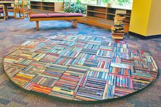 Pamela Paulsrud used several dozen books top create this floor sculpture. She incorporate books in her work as a way of exploring a new language, new perspective, and a new way to tell a story. Recycled Books, Art Carved, Magic Carpet, Altered Books, Popular Culture, A Table, Paper Art, Book Art, Cool Designs