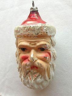 Vintage glass Santa ornament.                                                                                                                                                     More