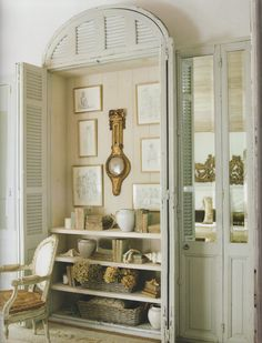 A closet with open doors becomes a lovely styled vignette with books, dried hydrangeas, and collectables. I love it!