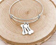 Personalized Dog Bone Bracelet  Have this bangle bracelet personalized with any name or word on the dog bones! This personalized bracelet makes the perfect gift for any dog/pet lover. Any name or word can be engraved onto the bone. All letters will appear in the style pictured - our lowercase Name Necklace, Arrow Necklace, Bangle Bracelets, Bangles, Sister Jewelry, Dog Bones, Personalized Necklace, Animal Jewelry, Bracelet Making