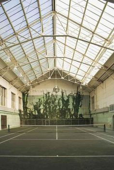 Gorgeous indoor tennis court with natural lighting