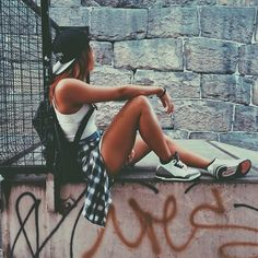 Flannel , white tank , shorts. This is a girl i would so be with. Her lax style and effortless vibe is totally what Im in to.