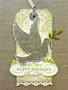 Petite Fleur Paperie - The little dove was heat embossed in pewter - it's gorgeous - it comes from the set Calm Christmas which also includes two beautiful sentiments ! By the way - when you trim out this dove and just at the last moment the foliage drops off - don't fret - just replace it with a piece punched from the bird builder punch - no one will notice !!!