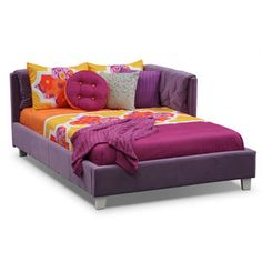 """Get Cozy. Doing homework, texting with friends or surfing the web, any girl would love to have a special place to curl up for some quality """"alone time,"""" and the Jordan Full corner bed provides just that. This fun-looking (and cleverly designed) bed has a cushioned reversible corner headboard covered in a teddy-bear soft, snazzy purple microfiber, button tufted detailing, fully upholstered rails and fashion forward feet. Its stylish look will transform your child's room, grow with her from…"""