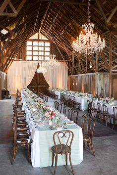 This rustic California barn venue is spectacular, with dramatic large doors. You can either dress it up or leave it rustic—it works for all styles. wedding chandelier A Barn Wedding Amongst The Towering California Redwoods! Redwood Forest Wedding, Forest Wedding Venue, Wedding Reception Layout, Rustic Wedding, Barn Weddings, Reception Ideas, Trendy Wedding, Wedding Ideas, Reception Checklist