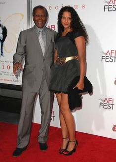 Sydney  Poitier and his daughter; Sydney in a suit is my definition of style, -- what a classy guy