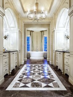 Love the ceiling & the arched vanities