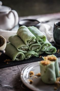 """This pandan (screwpine leaves) flavored crepes are stuffed with grated coconut cooked with gula jawa (coconut sugar) and rolled up like spring roll. So perfect as snacks or dessert. JUMP TO RECIPE I think my 3-year old son is approaching that stage of """"I'm done with naps"""".   #Coconut #Crepes #dadar #gulung #Stuffed"""