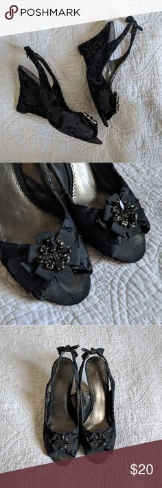 Nine West Black Embroidery-Style Peep Toe Wedges Ideal for holiday parties or a night out, these Nine West Black Embroidery-Style Peep Toe Wedges are super comfortable! So much detail in these shoes, you just can't help but love them! From the brooch embellishment across the toes to the petite ties on the back of the strap and of course, that elegant embroidery-style fabric throughout - stunning!  Size 9 US / 39 UK. Nine West Shoes Wedges