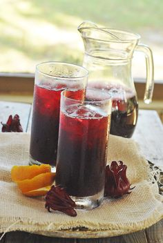 Jamaican Sorrel drink | 8 cups water 2 cups dried sorrel buds 2 inches ginger, grated 1 orange peel 6 allspice berries, optional Sweetener to taste Directions:  Bring water to boil in a large pot. Add sorrel, ginger, orange peel and allspice berries. Remove from heat and allow to steep for 2 hours or cool and place in the refrigerator overnight. Strain. Sweeten with your favorite sweetener. Refrigerate and enjoy!