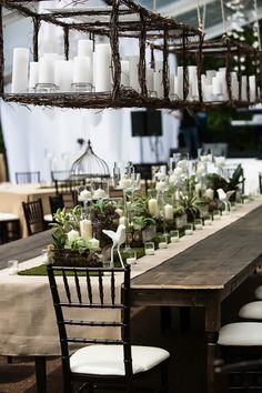 Long table displays  -- light fixture is amazing as well. Candles --galore