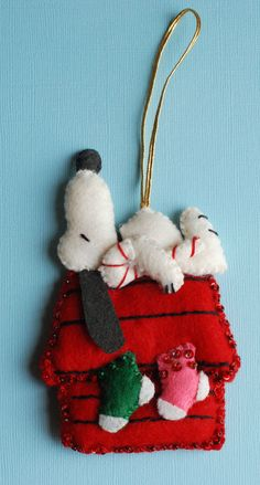 Snoopy Felt Ornament - ideas to make.  This was from a site that had the finished ornament from the 70's for sale.