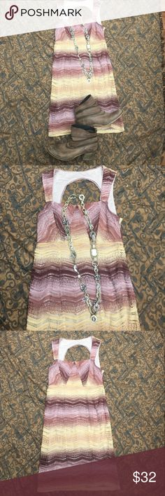 Beautiful free people dress Studying at free people dress size 6 with stretch. Gorgeous color combination perfect for the fall even in the winter time you could wear this as a tunic paired with some leggings and boots. You can find the other items in the photo in my closet and bundle for a discount. The dress is in good preowned condition Free People Dresses Mini