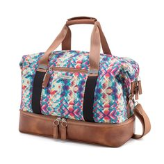 e5b5285577 The Midway Weekender has a spacious interior with lots of pockets and a  separate shoe compartment