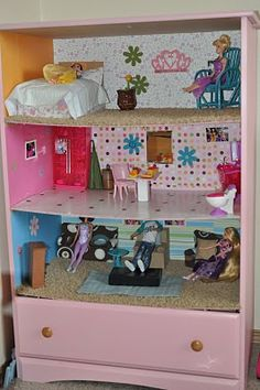 Turn an old dresser into a doll house, which also can give a drawer to store extra furniture and dolls...I would have loved this when I was a little girl!!