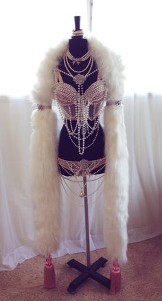Pink & Pearls Costume inspired by Claudette Barjoud's art for Fluff by the same name. Embellished with pearls, heavy crystal accents and crystal encrusted applique and topped off with a luscious faux fur boa with pink Lucite tassels!