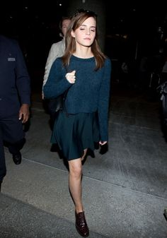 Emma Watson: blue knit sweater with pleated skirt and oxfords.